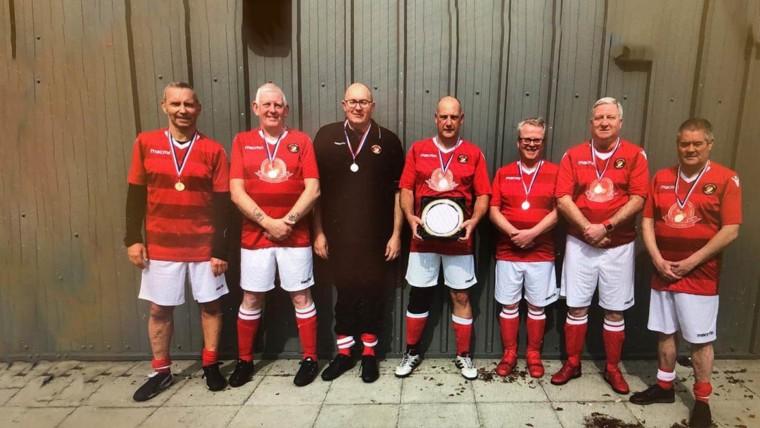 Walking football squad add first silverware